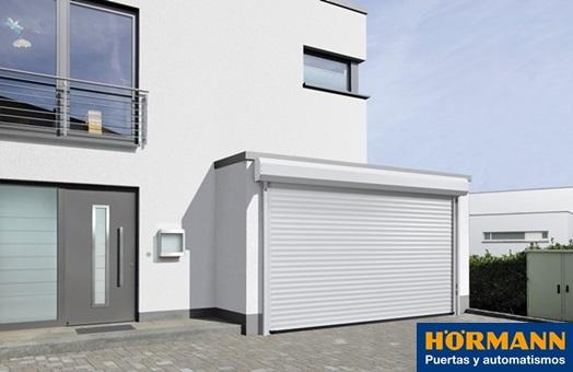 Puerta enrollable rollmatic para garajes y comercios for Puertas para garajes