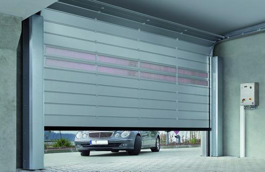 H rmann presenta la nueva puerta seccional speed hs 5015 for Puertas de cochera automaticas